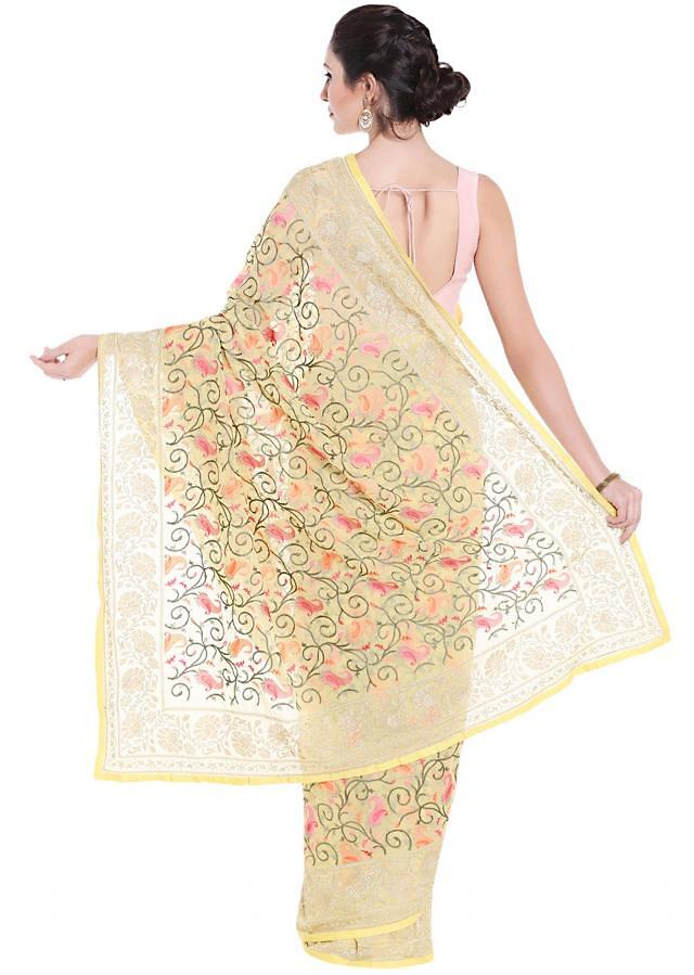 Yellow saree in georgette with resham jaal motif embroidery only on Kalki