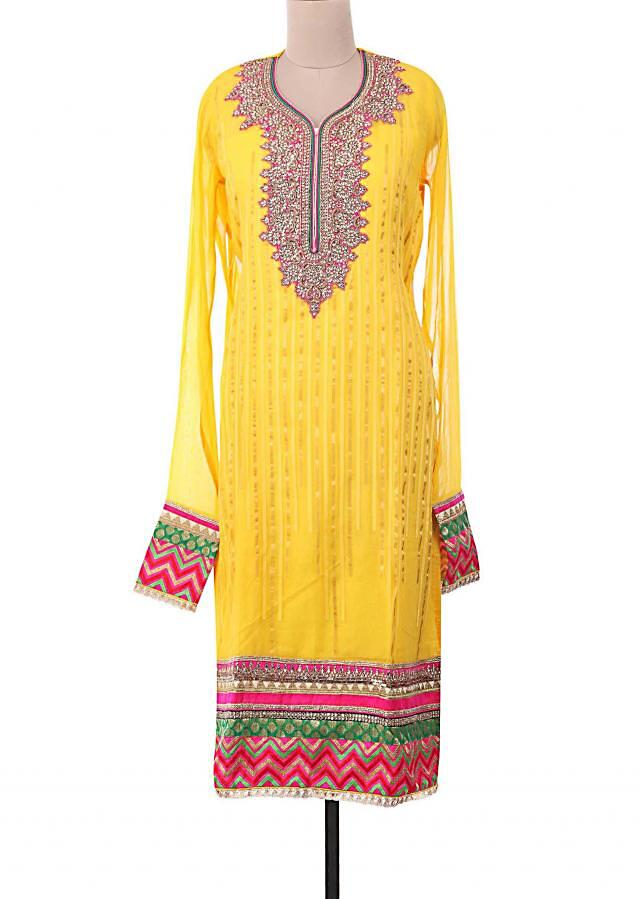 Yellow semi-stitched suit embellished in patchwork and gotta patti lace only on Kalki