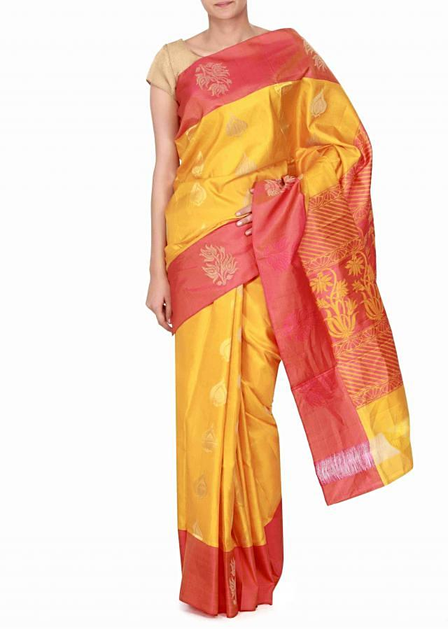 Yellow silk saree enhanced in weave butti only on Kalki