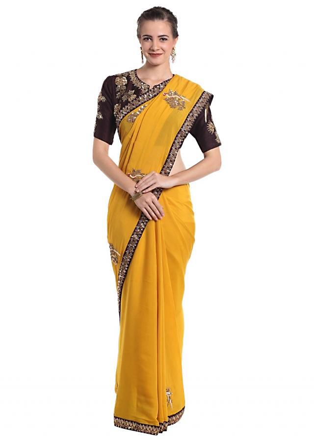Yellow silk saree featuring bird motifs crafted with zardosi embroidery only on Kalki