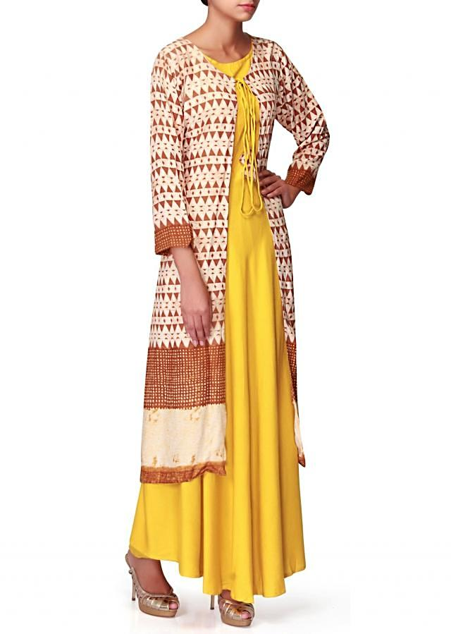 Yellow slip dress with brown printed jacket only on Kalki