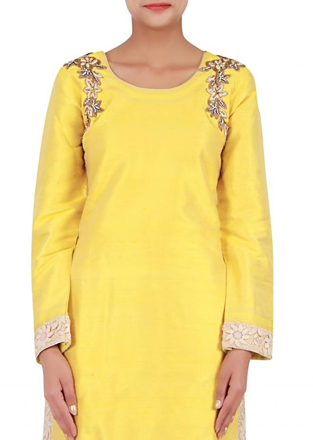 Yellow straight fit suit embellished in thread and patchwork only on Kalki