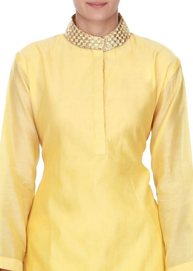 Yellow straight suit in applique butti only on Kalki