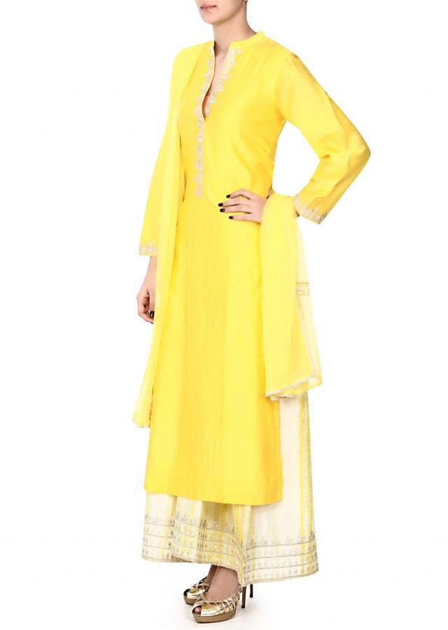 Yellow straight suit with zari placket only on Kalki