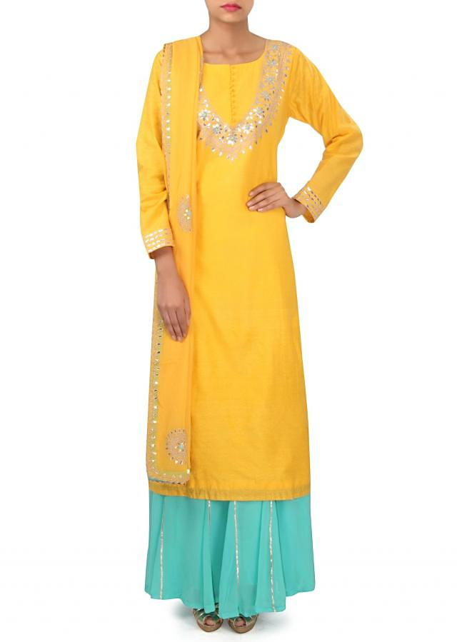 Yellow suit adorn in gotta patch embroidery only on Kalki