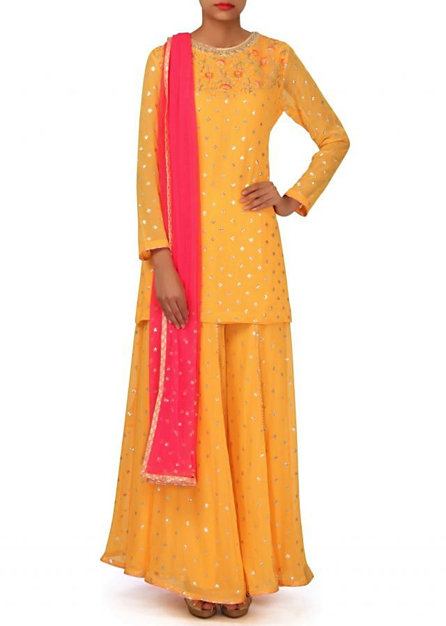Yellow suit embellished in gotta and resham only on Kalki