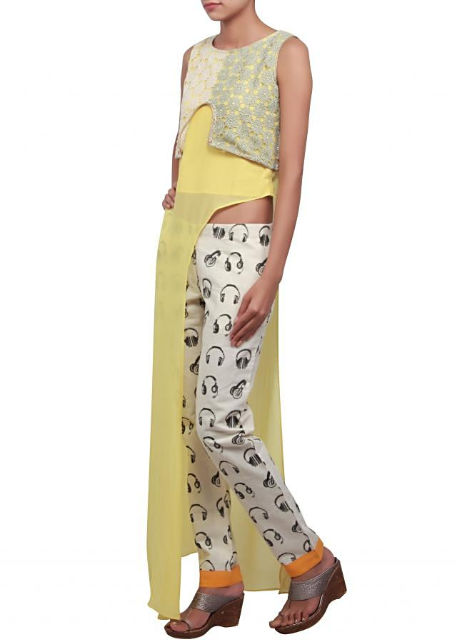 Yellow suit enhanced in croquet lace only on Kalki