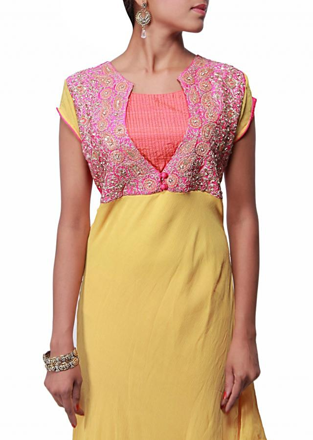 Yellow suit featuring with bodice embellished in pearl and zari only on Kalki