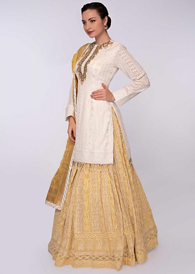 Yellow Lehenga Embroidered In Thread And Paired With White Kurti Online - Kalki Fashion