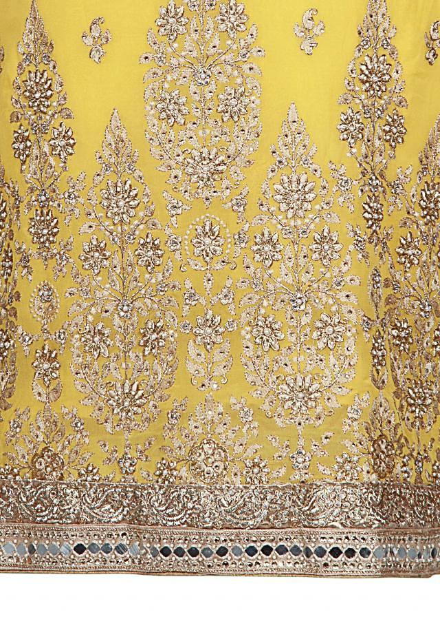 Yellow unstitched suit adorn in kundan and sequin embroidery only on Kalki