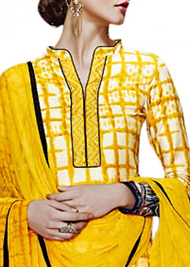 Yellow unstitched suit adorn in resham embroidery