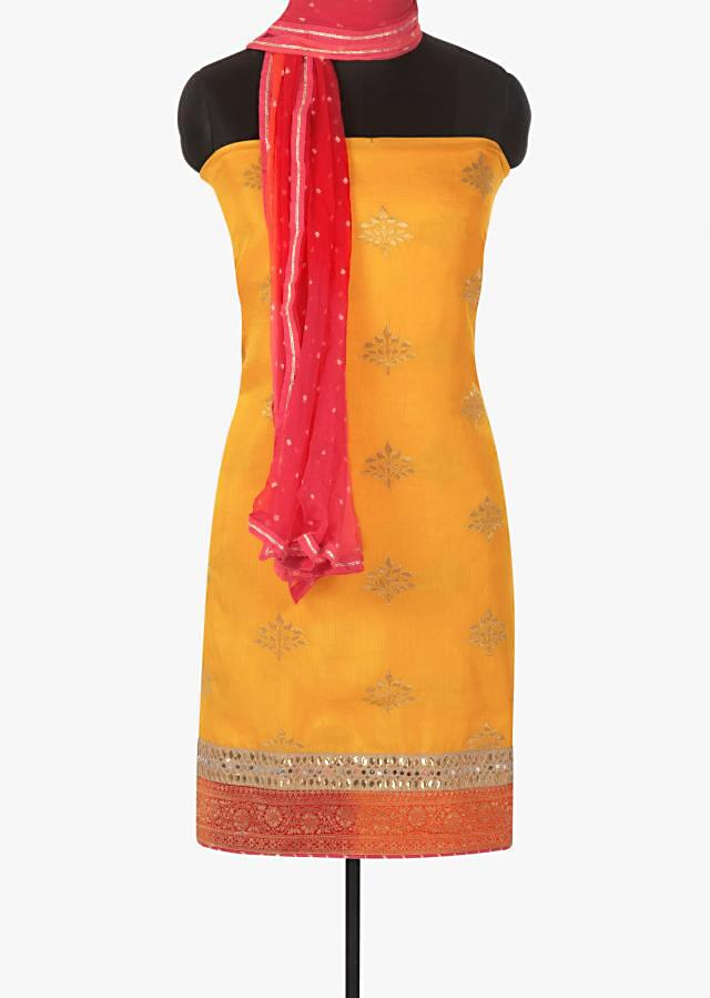 Yellow unstitched suit in cotton silk highlighted with lace and brocade border only on Kalki