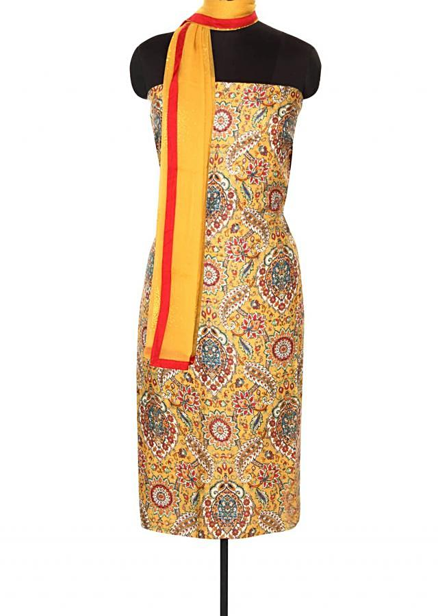 Yellow unstitched suit in floral and paisley print only on Kalki
