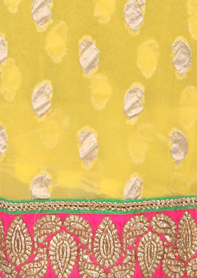 Yellow unstitched suit in paisley motif weave only on Kalki