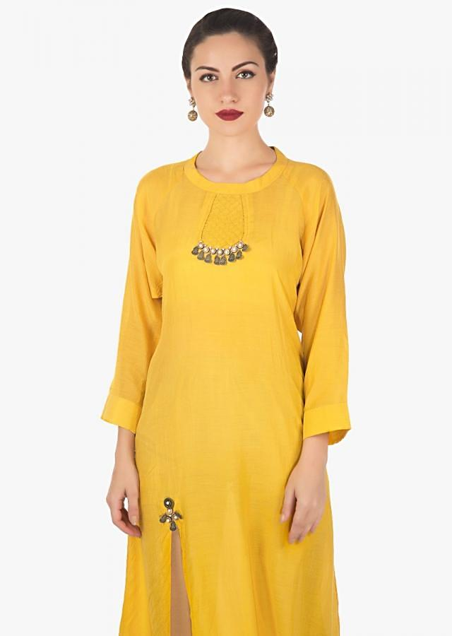 Yellow A line kurti in cotton silk with pin tucks and fancy tassel only on Kalki