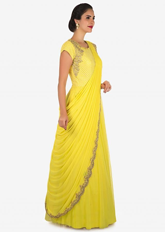 Yellow anarkali gown with ready pleated dupatta adorn in cut dana embroidery work only on Kalki