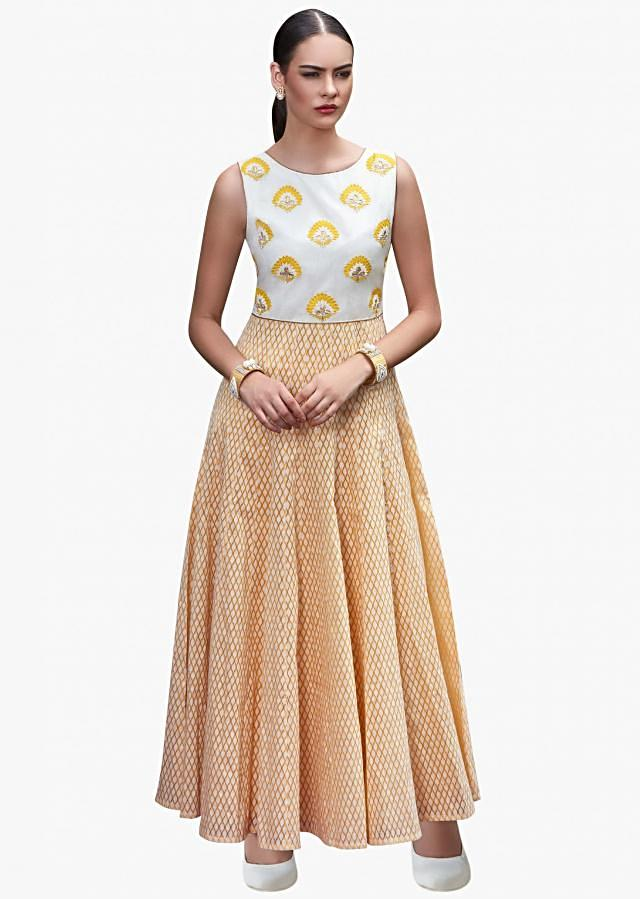 Yellow anarkali suit with a net dupatta enhanced in resham and gotta-patch work.