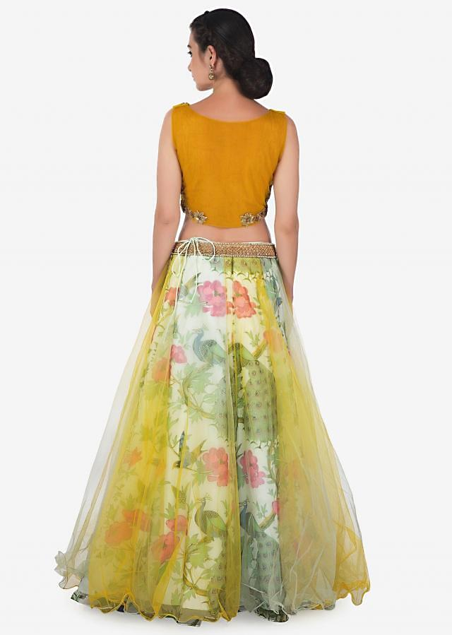 Yellow and green lehenga with embroidered ready blouse only on Kalki