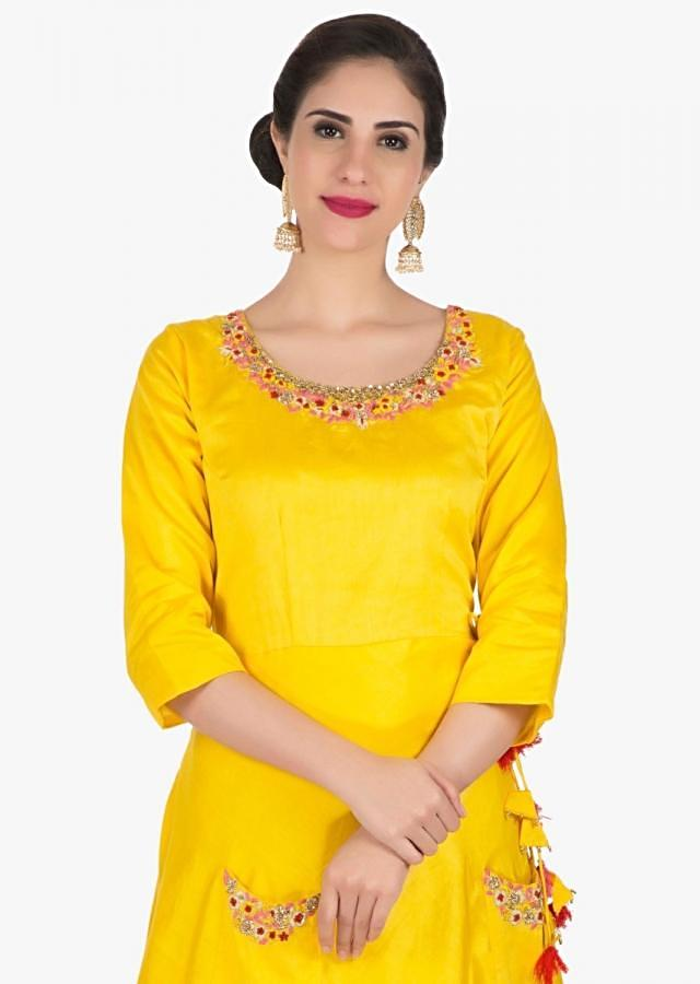 Yellow dress in cotton silk embellished with  resham and french knot embroidery work only on Kalki