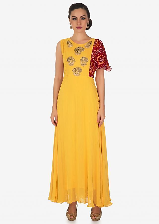 Yellow dress with embroidered bodice and fancy bandhani printed sleeve only on Kalki