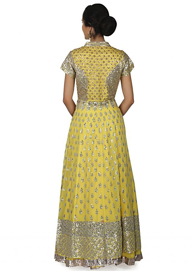 Yellow long jacket with lehenga embellished in gotta patch embroidery only on Kalki