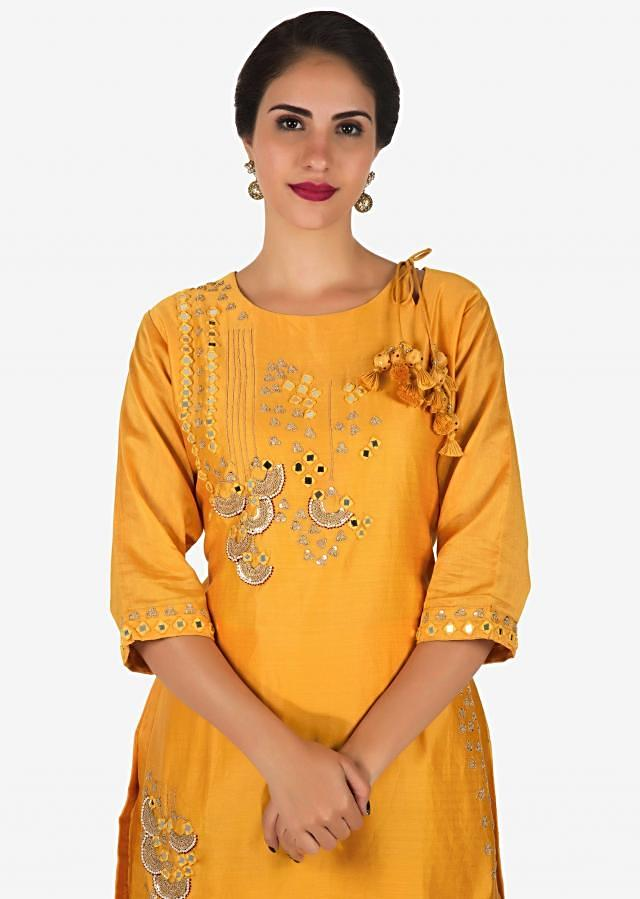 Yellow palazzo suit in cotton adorn in zari and moti embroidery work only on Kalki