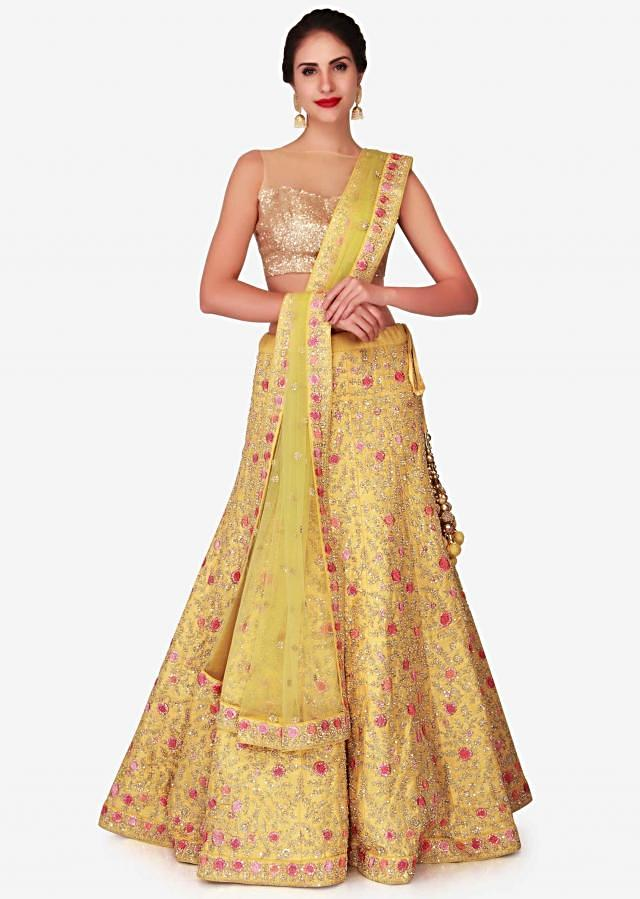 Yellow raw silk lehenga embellished with resham and moti embroidery work only on Kalki