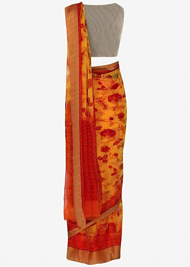 Yellow saree featuring in georgette with orange floral print all over only on Kalki