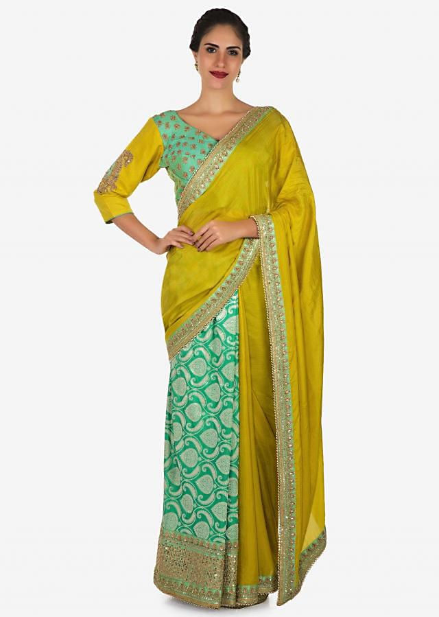 Yellow saree in cotton with ready stitched blouse embellished in zari butti embroidery only on Kalki