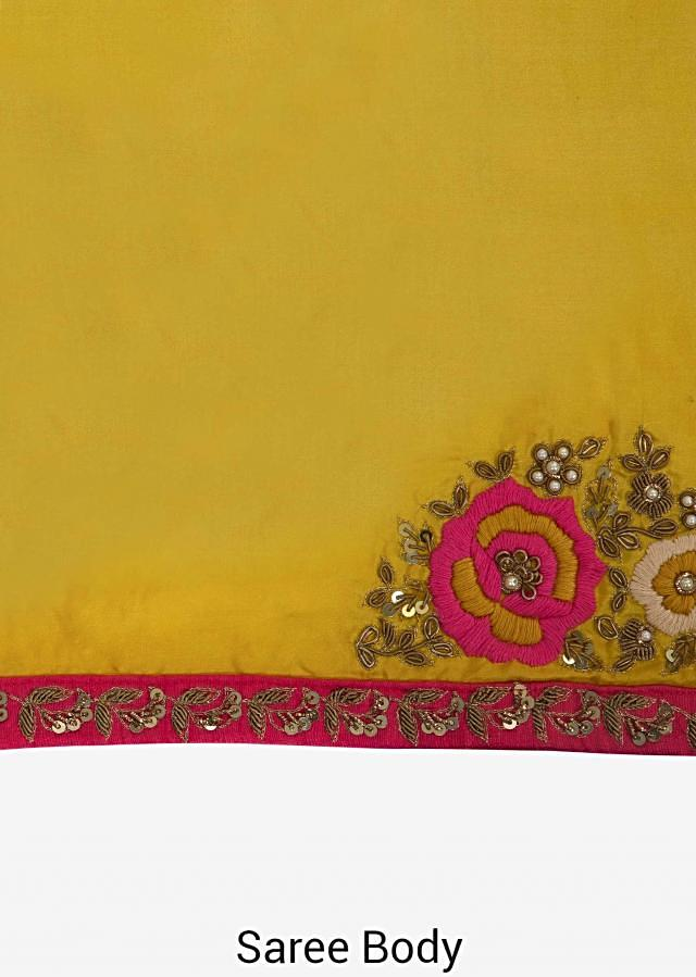 Yellow saree in satin silk beautified in resham and zardosi embroidery work only on Kalki