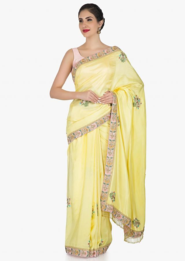 Yellow saree in satin silk embellished with sequin and resham embroidery work only on Kalki