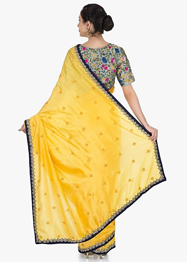 Yellow saree in silk with ready stitched blouse beautified in resham and cut dana work only on Kalki