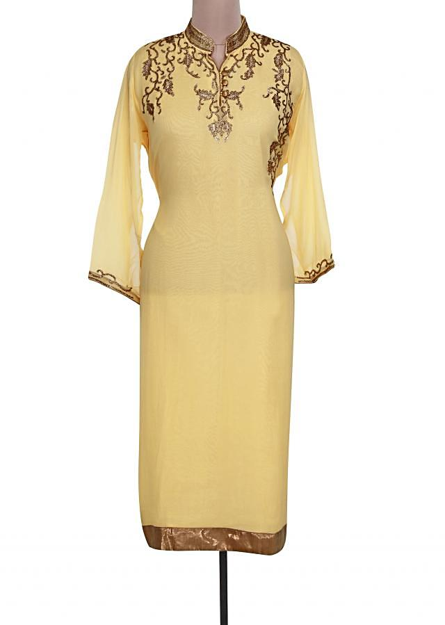 Yellow semi stitched suit adorn in kundan embroidery only on Kalki