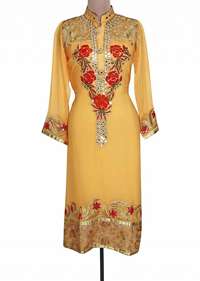 Yellow semi stitched suit embellished in mirror and zari only on Kalki