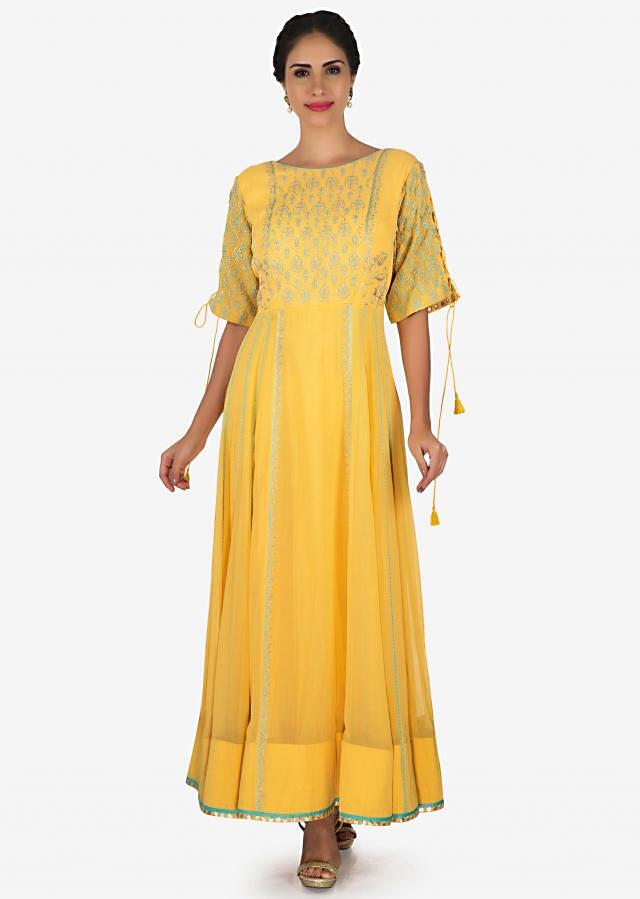 Yellow suit in georgette enhanced in zari embroidery work only on Kalki