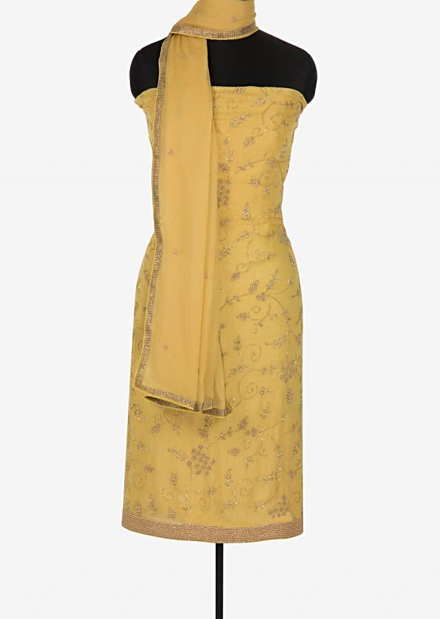 Yellow unstitched suit in shimmer georgette embellished in moti and cut dana work only on Kalki