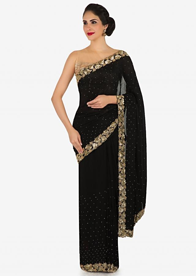 Zed black saree features in chiffon with leaf motif border only on Kalki