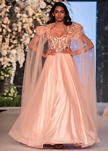 f830843431d2 Ice pink corset gown in net with fancy cape highlighted in feathers only on  Kalki