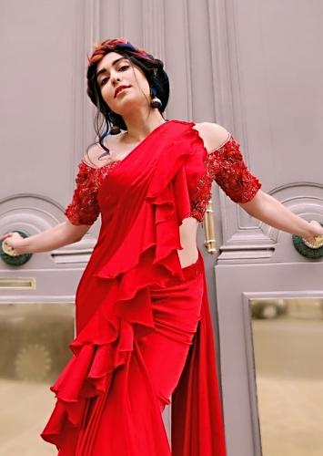 Adah Sharma In Kalki Cherry Red Saree In Satin With Stitched Ruffle Pallu Embellished Blouse And Belt