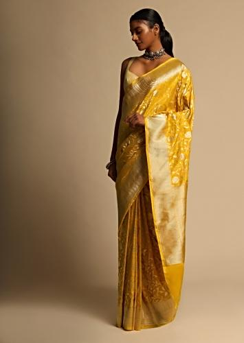 Amber Yellow Banarasi Saree In Pure Handloom Silk With Woven Floral Jaal And Chevron Border Along With Unstitched Blouse Piece Online - Kalki Fashion