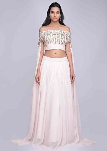 b2f47267fb34 Baby pink georgette skirt with fancy cape sleeved crop top set only on Kalki