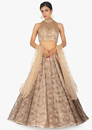 f5e3ac32a8 Beige satin net lehenga set in sequins and zari embroidery only on Kalki