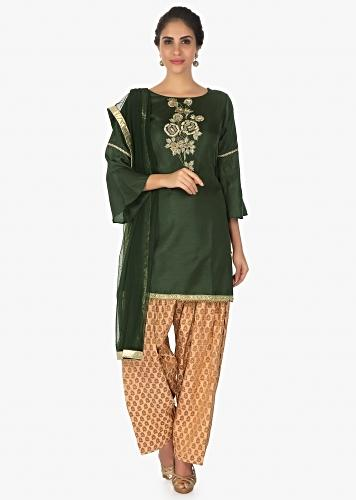 77b8baf7b2 Green raw silk embellished top paired with beige weaved pant and net dupatta  only on Kalki