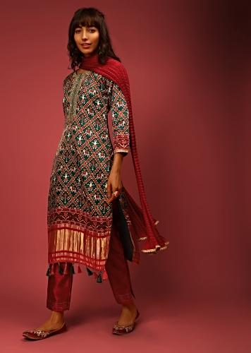Bottle Green Straight Cut Suit In Satin Blend With Patola Print And Brocade Border Edged In Tassels Online - Kalki Fashion