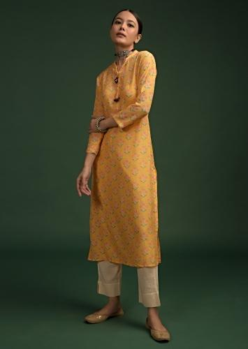 Bright Yellow Straight Cut Kurti In Cotton With Printed Floral Buttis And Tassels On The Placket Online - Kalki Fashion