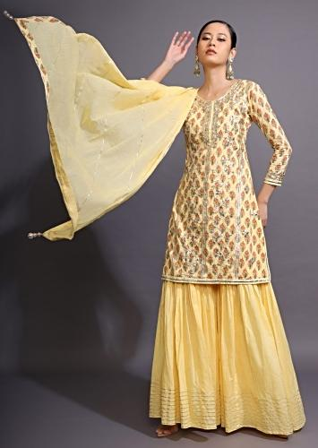 Canary Yellow Sharara Suit With Gotta Patti Work And Printed Buttis Online - Kalki Fashion