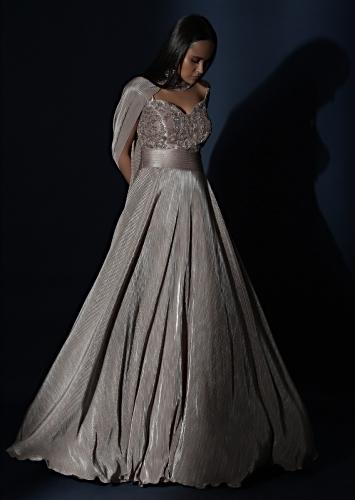 Champagne Gown In Crushed Shimmer With An Embellished Bodice Highlighting The Waistline And Fancy Cape Online - Kalki Fashion