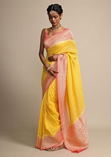 Chrome Yellow Weaved Georgette Saree With Contrasting Coral Border Online - Kalki Fashion