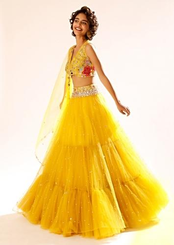 Citrus Yellow Lehenga Choli With Fancy Front Cut Out Detailing And Colorful Resham Embroidered Floral Design Online - Kalki Fashion