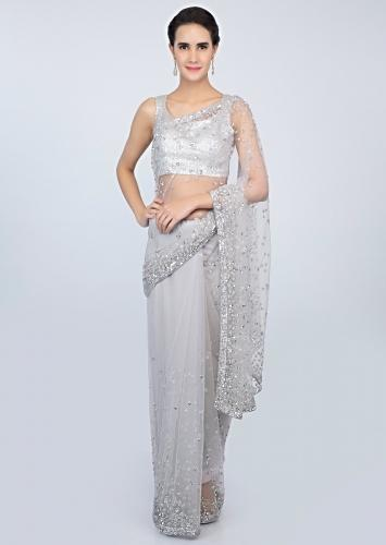 35fd0f38805b46 Coin grey sheer net saree with sequins embroidered butti and border only on  kalki